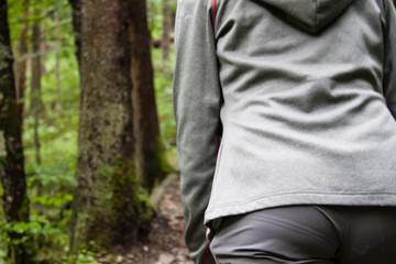 Fototapeta Young women hiking in the woods