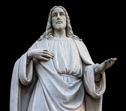 a statue of jesus with open hands. isolated