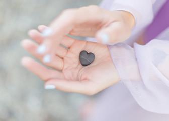 Stone heart in hands