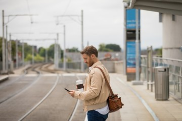 Man using mobile phone in platform