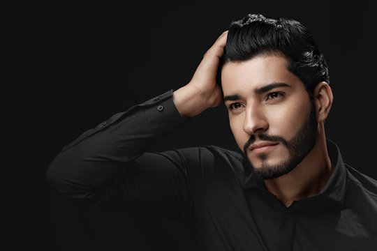 Men Hair Beauty. Handsome Male Model Touching Healthy Hair