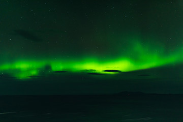 norwegian aurora borealis with mountains and water, view from hurtigruten ship boat, norway, europe, green northern lights