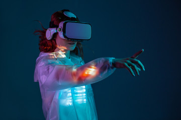 Woman touching air in VR glasses