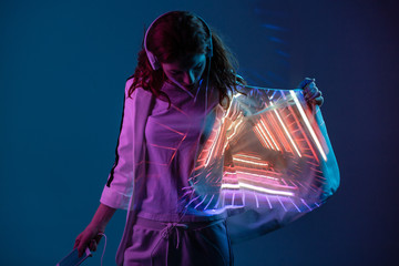 Woman in headphones with projected light on jacket