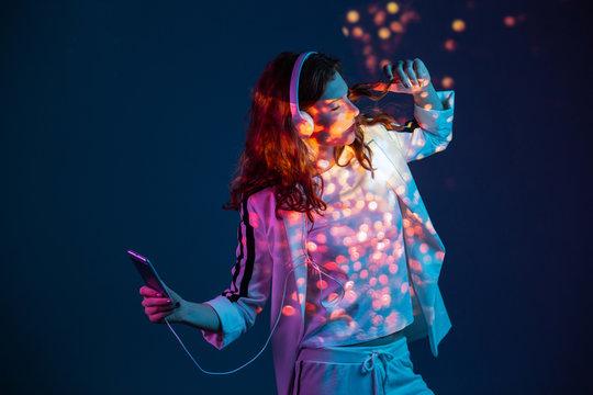 Woman enjoying music with mobile phone