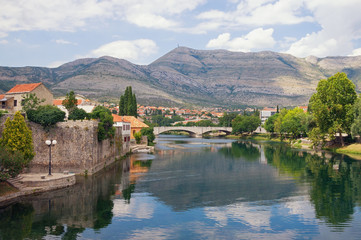 Ancient town on river bank. Bosnia and Herzegovina, Republika Srpska. View of Trebisnjica river and Old Town of Trebinje