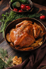 Homemade roasted chicken on a rustic wooden background. Close up