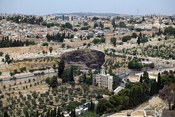 view of the old city of Jerusalem in Israel with an olive mountain.