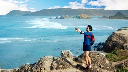 Female hiker taking selfie on Merese hill