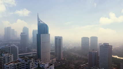 Jakarta cityscape with skyscraper in misty morning