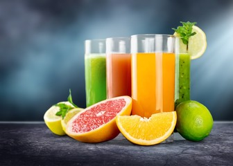 Wall Murals Juice Tasty fruits and juice on wooden table