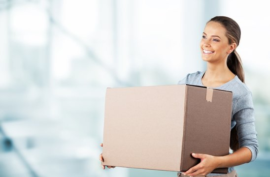 Woman moving into new house isolated on white