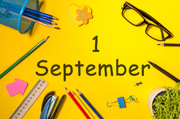 1st September. Image of september 1, calendar on yellow background with office supplies. Back to school concept