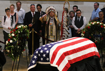 Glynn A. Crooks, Viet Nam veteran and former Chairman of the Shakopee Mdewakanton Sioux Indian Community of Prior Lake, MN. salutes the casket of Senator McCain who lies in state in the Rotunda at the U.S. Capitol in Washington
