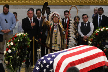 Glynn A. Crooks, Viet Nam veteran and former Chairman of the Shakopee Mdewakanton Sioux Indian Community of Prior Lake, MN. pays his respects at the casket of Senator McCain who lies in state in the Rotunda at the U.S. Capitol in Washington
