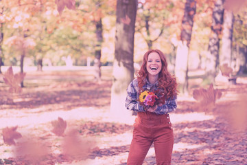 happy woman in autumn with red hair