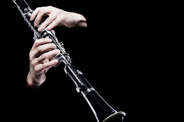 Photo sur cadre textile Musique Clarinet player hands isolated