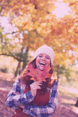 young redhead laughing woman in october landscape