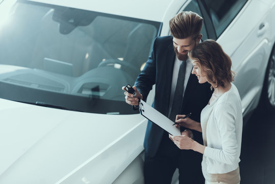Car Salesman Consultant Showing Contract to Woman