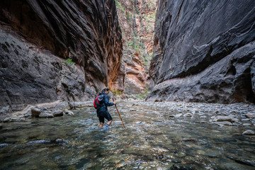 Young Female Hiking Through the Narrows, Zion National Park - USA