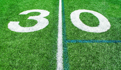 numbers marking the 30 yard line on an American football field