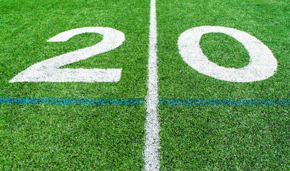 numbers marking the 20 yard line on an American football field