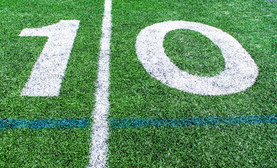 numbers marking the 10 yard line on an American football field