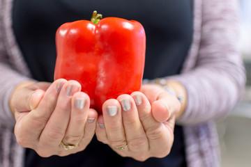 red pepper in hands