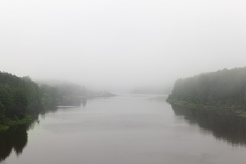 river in cloudy foggy weather Fototapete