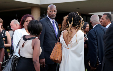 Family and friends leave the church following the funeral service for the late singer Aretha Franklin at the Greater Grace Temple in Detroit