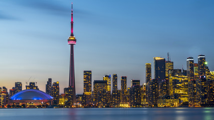 Long exposure of Toronto, Ontario - Canada. Bright sky with a smooth water surface. Beautiful city lights seen from the Toronto Island