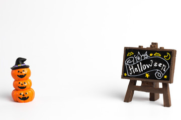 Halloween pumpkins stacked three balls and brown label with a halloween text and center copy space.