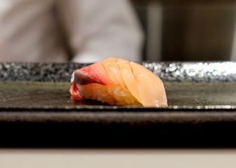 Freshly prepared raw sushi on a plate