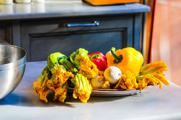 Fresh vegetables in the sunlight in a kitchen on a plate
