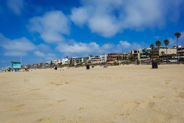 Sandy Manhattan beach with palms and mansions in Los Angeles