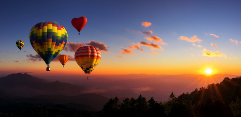Fotobehang Ballon Hot air balloons with landscape mountain.