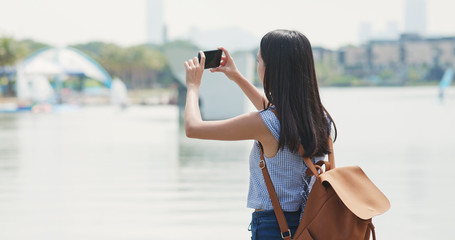 Woman use of smart phone for take photo in city of Shenzhen
