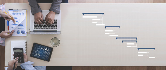 Business People Analyzing  PROJECT MANAGEMENT updating Gantt chart