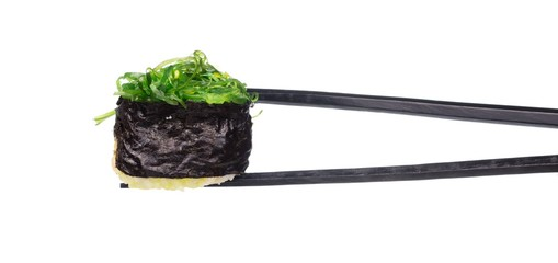 holding sushi by chopsticks isolated on white background