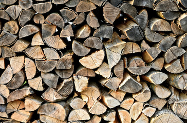 Firewood stacked with full frame for texture or background..dried wood for winter season.