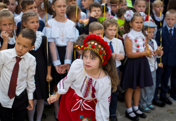 First graders attend a ceremony to mark the start of the school year in Kiev
