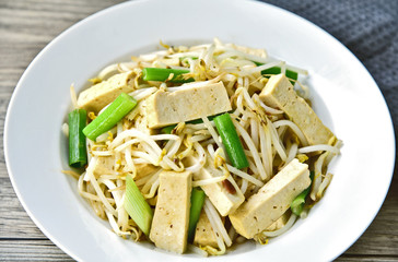 Stir Fried Bean Sprouts with tofu and scallion. Asian vegetable stir fry
