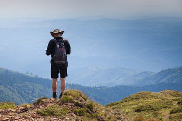 male hiker trekking in the mountains