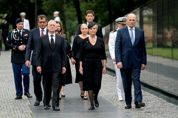 Cindy McCain, wife of, Sen. John McCain, R-Ariz., accompanied by President Donald Trump's Chief of Staff John Kelly, Defense Secretary Jim Mattis, and family members, arrives at at the Vietnam Veterans Memorial in Washington