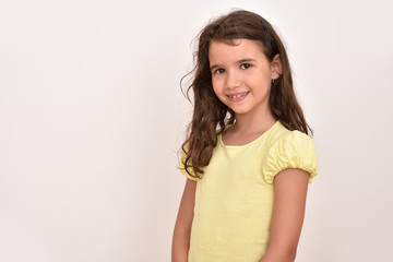 Portrait of a smiling cute young girl. Copy space on the left side.