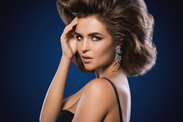 Gorgeous woman with a beautiful hairstyle and make-up