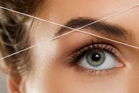 Eyebrow threading - epilation procedure for brow shape correction