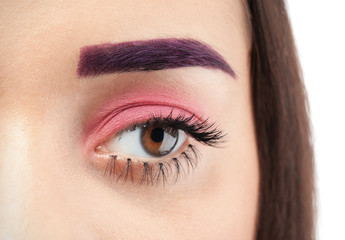 Young woman with dyed eyebrow and creative makeup, closeup