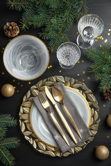 Elegant table setting on dark background, top view. Christmas celebration