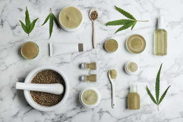 Flat lay composition with hemp lotion on marble background